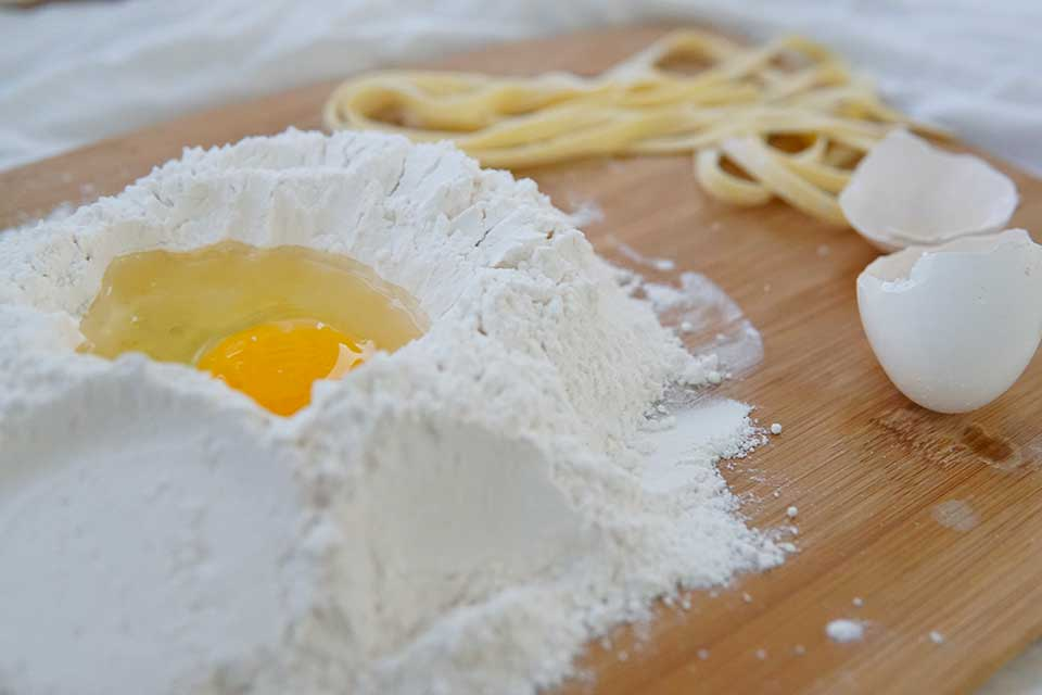 flour and egg on a wooden table